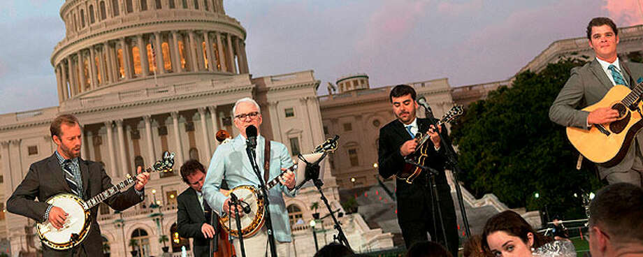 "Steve Martin (center) performs with the Steep Canyon Rangers during ""A Capitol Fourth"" concert in Washington D.C. KRIS CONNOR / GETTY IMAGES"