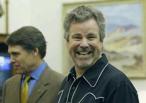 "Singer and songwriter Robert Earl Keen, right, smiles during a meeting with Texas Gov. Rick Perry, in the governor's office, May 11, 2005, in Austin. The governor proclaimed ""Robert Earl Keen Week,"" to coincide with the release of Keen's latest album. Photo: HARRY CABLUCK, AP / AP"
