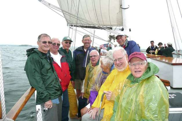 Eight of the 18 circumnavigators who sailed on Yankee back in 1953, plus a son of a late crew member, took part in a blustery reunion sail along the Greenwich coastline aboard the SoundWaters schooner. They are, standing from left, Roger Bellinger, John Herrick, Robert Johnson, Sean Bercaw, son of Jay Bercaw and Dick Blair. Seated are Mike Wilcox, Lydia Edes Jewel, Ken Viard, and David Wilkins. One crew member, Edith Corning stayed ashore. Photo: Anne W. Semmes