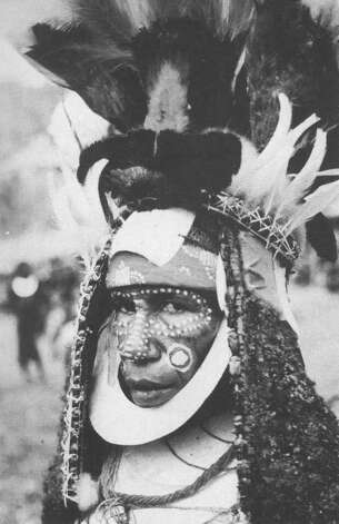 The crew of the Yankee visited many exotic ports of call and saw many fascinating sights. Here, a well-dressed woman from the New Guinea Highlands sports a Bird of Paradise crown. Photo: Contributed Photo