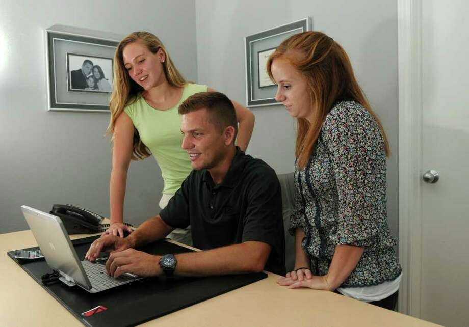 Wade Martinez, president of CBS Services Inc., works with his summer employees, Mary Lyman, 19, left, a 2010 graduate of Klein High School and a business management major at Brigham Young University, and Meg Crowley, 19,  a 2009 graduate of Klein High School and a biology major at Centenary College of Louisana. Photo: Jerry Baker, Freelance