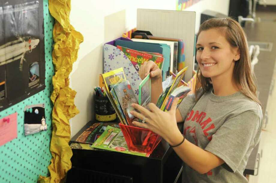 Jennifer Setterbo, 28, a first-year science teacher at Tomball Intermediate, works on setting up her room for the first day of school. Photo: Jerry Baker, Freelance