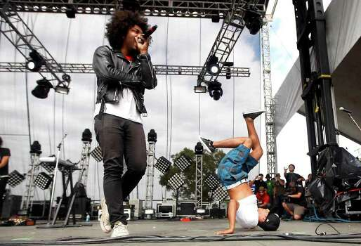 Rah Almillio of the Knux performs, left, while one of the members of the Austin Group Bboy City dance during the 2009 Austin City Limits Music Festival at Zilker Park in Austin, Texas on Friday, Oct. 2, 2009. (AP Photo/Austin American-Statesman, Ricardo B. Brazziell) **MAGS OUT; NO SALES; TV OUT; INTERNET OUT; AP MEMBERS ONLY** Photo: Ricardo B. Brazziell, MBR / Austin American-Statesman