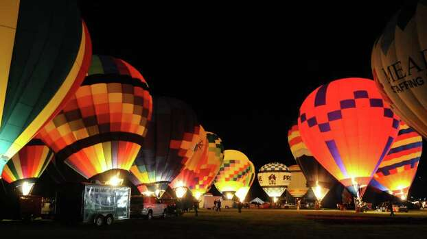 Several balloons inflate getting ready for what is called the glow at the Clear Lake's annual Ballunar festival held at NASA 10/24/09. Photo: Kim Christensen, Freelance / Freelance