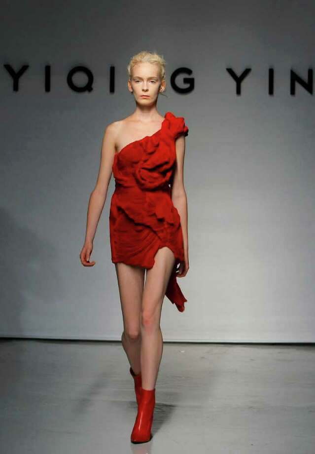 A model wears a creation for the Yiqing Yin Fall-Winter 2011-2012 Haute Couture fashion collection presented in Paris, Thursday, July 7, 2011. (AP Photo/Jacques Brinon) Photo: Jacques Brinon, STF / AP