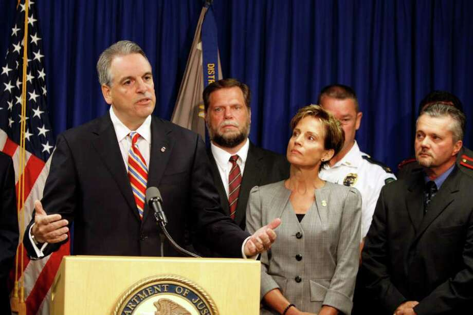 Peter Neronha, U.S. attorney for the district of Rhode Island, announces a $500 million settlement with Internet giant Google over Canadian drug advertisements Wednesday, Aug. 24, 2011, in Providence, R.I. The agreement settles a federal investigation into Google's distribution of online ads from Canadian pharmacies that were illegally selling prescription and non-prescription drugs to American consumers. (AP Photo/Joe Giblin) Photo: Joe Giblin, FRE / FR88264 AP