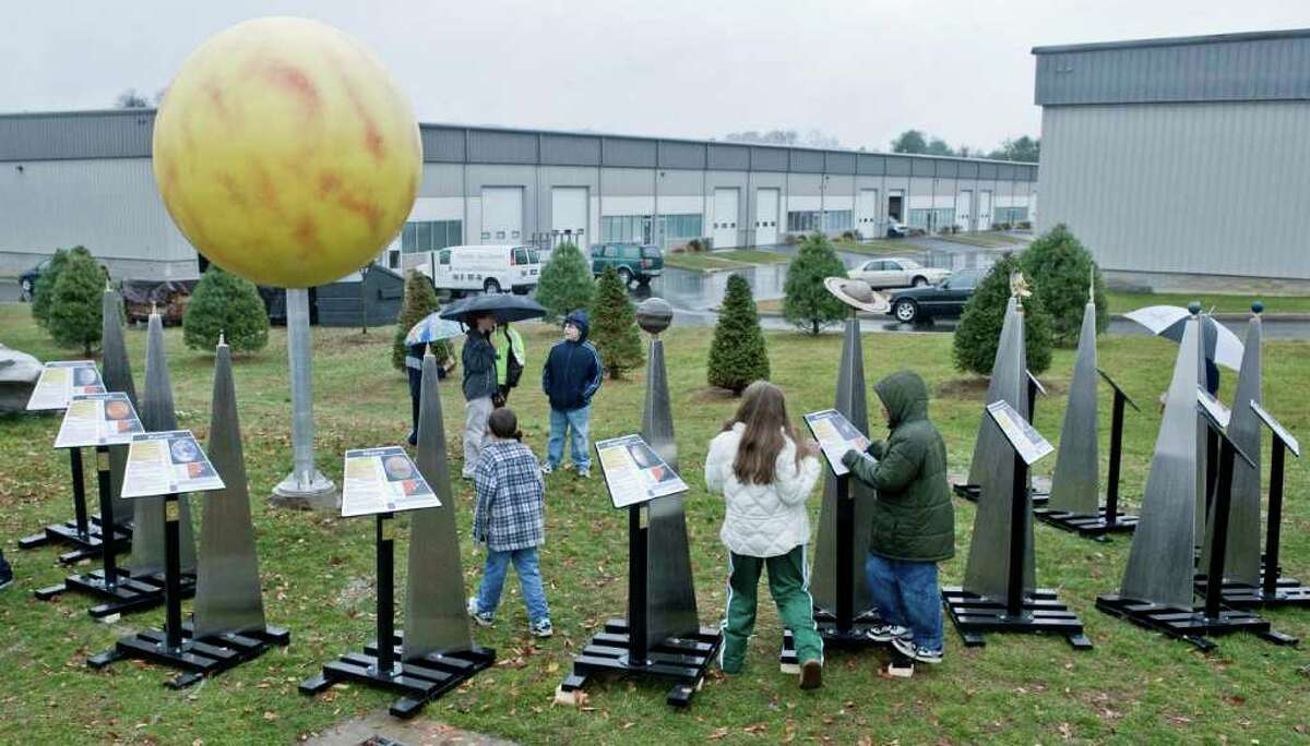 A display planets is photographed at the dedication ceremony for the McCarthy Observatory Scale Solar System in New Milford in this 2009 file photo.
