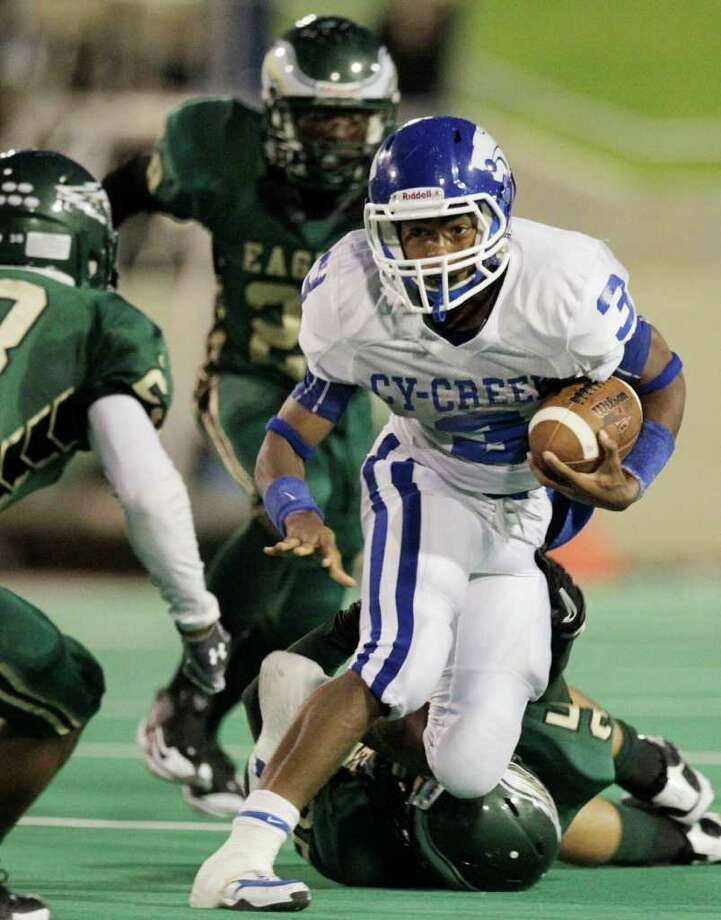 Cy Creek running back Devan Demas moves the ball upfield in the second quarter of a prep football game between Cy Creek and Cy Falls at Pridgeon Stadium on Friday, Sept. 17, 2010, in Cypress. ( Julio Cortez / Houston Chronicle ) Photo: Julio Cortez, HC Staff / Houston Chronicle