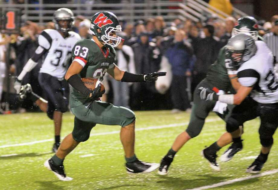 The Woodlands' wide receiver Blake Webb follows the block of Brett Felton into the end zone during the College Park at The Woodlands football game. Photo: David Hopper, Freelance / Freelance