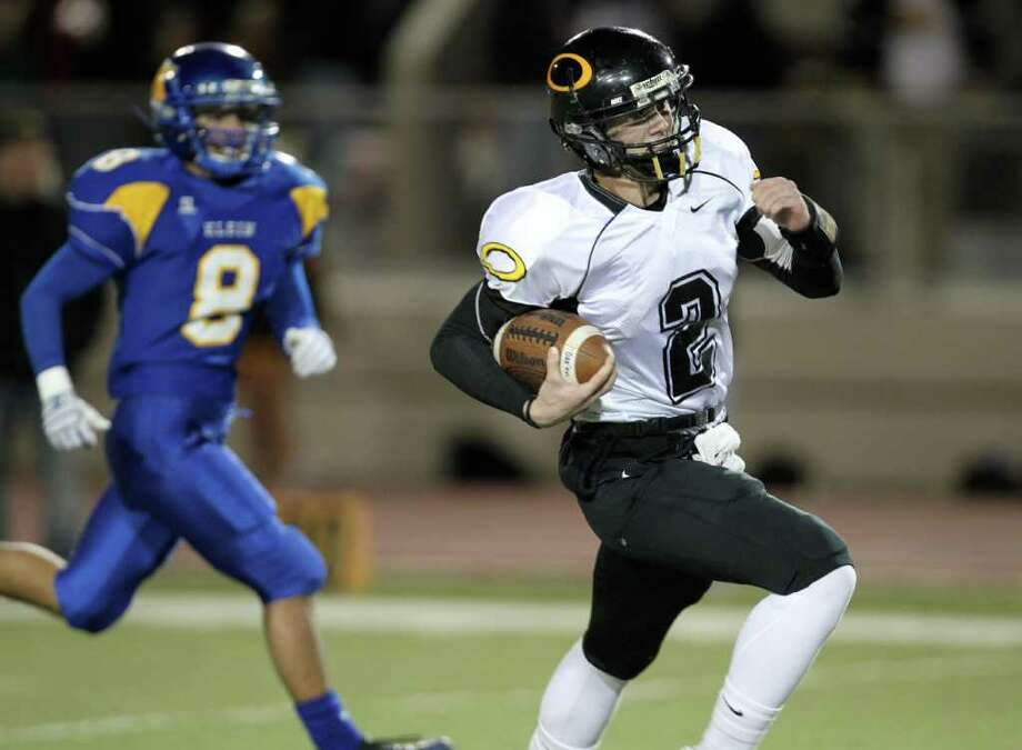 Klein Oaks' quarterback Nicky Baratti (right) runs with the ball to score a touchdown against Klein during the first quarter of District 13-5A high school football game action at Klein Memorial Stadium Friday, Nov. 5, 2010, in Houston.    ( James Nielsen / Houston Chronicle ) Photo: James Nielsen, HC Staff / Houston Chronicle