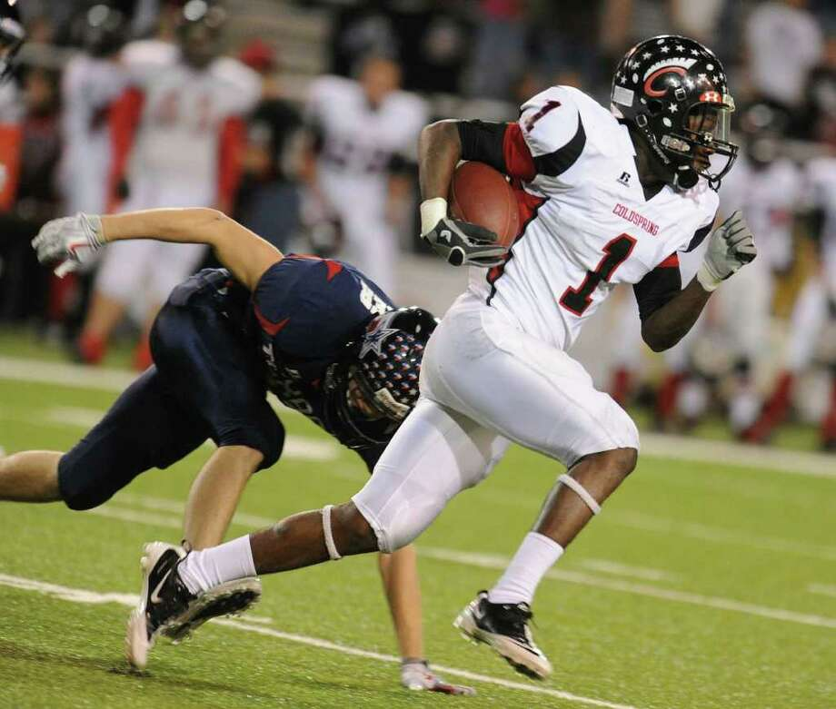 Coldspring's Sherman Gilbert (1) right runs for a touchdown past Wimberley's Josh Gray (10) left, in the first half of their 53A, Division 2,  playoff game at Floyd Casey Stadium, Friday, Dec. 10, 2010 in Waco, Texas. (Special to the Chron. Rod Aydelotte) / Freelance