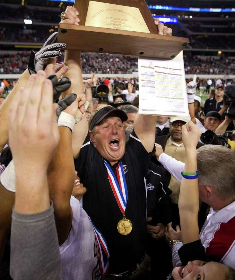 Pearland head coach Tony Heath hoists the championship trophy the Oilers defeated the Euless Trinity Trojans for the state title of the Class 5A, Division 1 state championship game at Cowboys  Stadium on Saturday, Dec. 18, 2010, in Arlington.  Pearland won the game 28-24.  ( Smiley N. Pool / Houston Chronicle ) Photo: Smiley N. Pool, Staff / Houston Chronicle