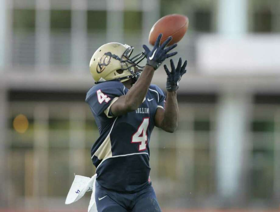 Klein Collins' Shane Rhodes hauls in the game-winning, 56-yard touchdown reception late in the fourth quarter of their 28-21 victory over Dekaney, Saturday at Klein Memorial Stadium. Photo: ERIC CHRISTIAN SMITH, Freelance / Freelance