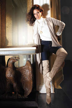 FLY GIRL: Jennifer Lopez Collection flyaway cardigan, $60; straight denim jeans, $54; circle pendant necklace, $32; hoop earrings, $24; and lucille over-the-knee stretch boots, $119; All at Kohl?s. Photo: Kohl's