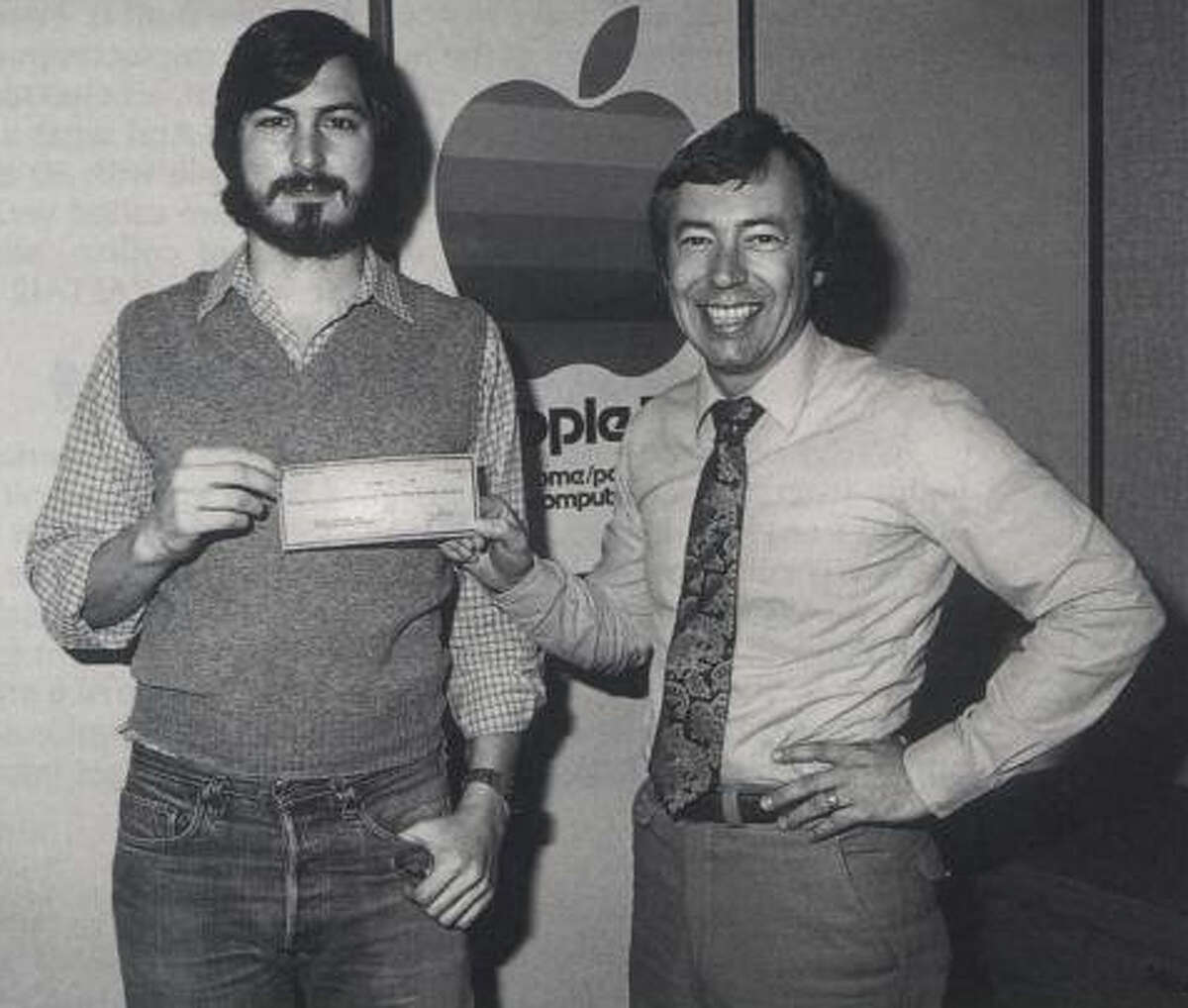 """Steve Jobs receives an infusion of cash from venture capitalists Don Valentine and Mike Markkula, pictured here, to start Apple. This is a still from the film """"Something Ventured."""""""