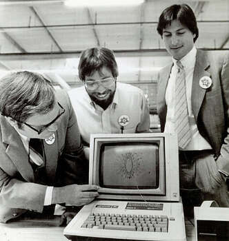 "Owen Whetzel, president of the Sunnyvale school board, left, takes a close look at an Apple Computer in July 1983 with Steve Wozniak, co-founder, center, and Steve Jobs, Chairman of the board of Apple Computer, Inc., at right. Apple announced the start of the first shipment of 9,000 computers to virtually every school in the state of California in a massive giveaway aimed at promoting ""computer literacy"" in the primary and secondary schools. The first and millionth produced were given to the Sunnyvale School District. Photo: Courtesy / UPI 1983"