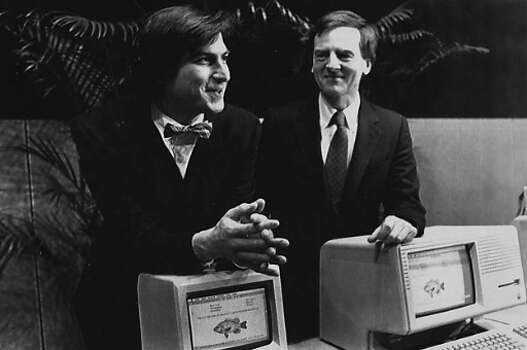 Steve Jobs (left) with bow tie and John Sculley at the Apple Computers annual meeting on January 24, 1984. Photo: Cap Carpenter / AP