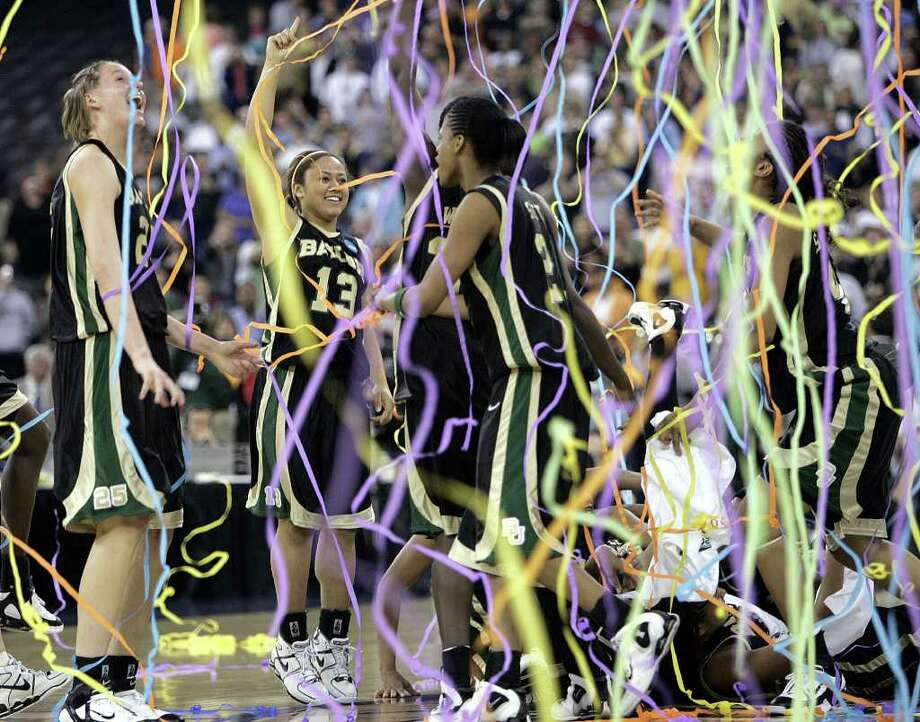 Baylor players celebrate their 84-62 over Michigan State in the NCAA women's national championship game Tuesday April 5, 2005, in Indianapolis. (AP Photo/Ann Heisenfelt).  HOUCHRON CAPTION (04/06/2005) SECNEWS COLORFRONT:    EXHILARATION: The Lady Bears dance amid streamers and confetti after claiming the national championship Tuesday against Michigan State. Photo: ANN HEISENFELT / AP