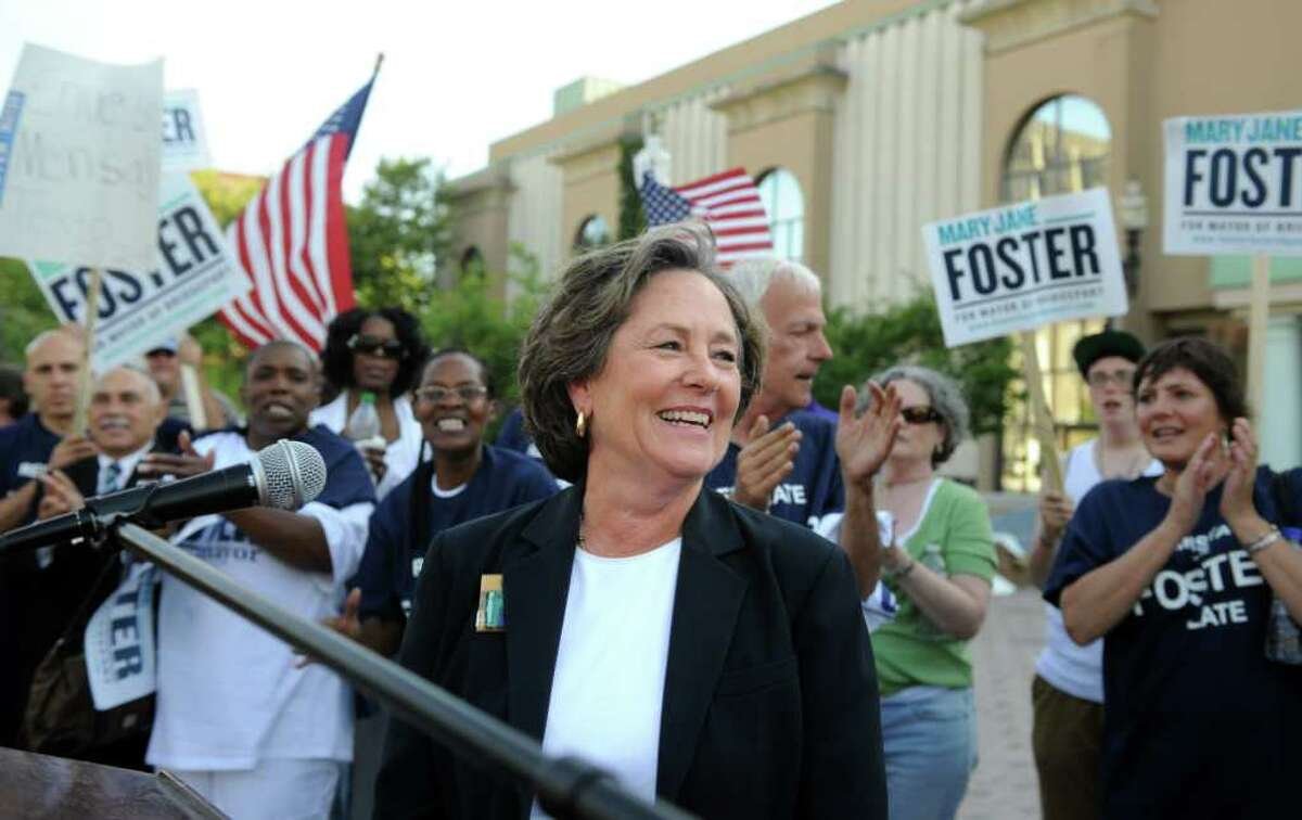 Supporters gathered on the steps of City Hall Annex in Bridgeport, Conn. applaud mayoral hopeful Mary- Jane Foster during a