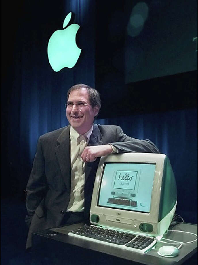 Apple Computers Inc. interim chief executive Steve Jobs unveils the the new iMac computer in Cupertino in May 1998. Photo: Paul Sakuma / AP