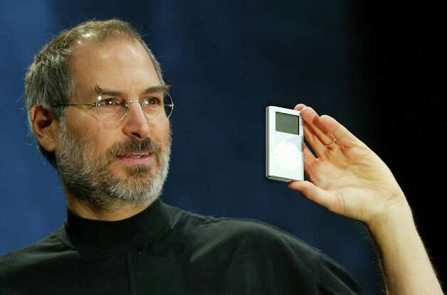 Jobs holds a new mini iPod at Macworld in San Francisco, Jan. 6, 2004. Photo: Justin Sullivan, Getty Images / 2004 Getty Images
