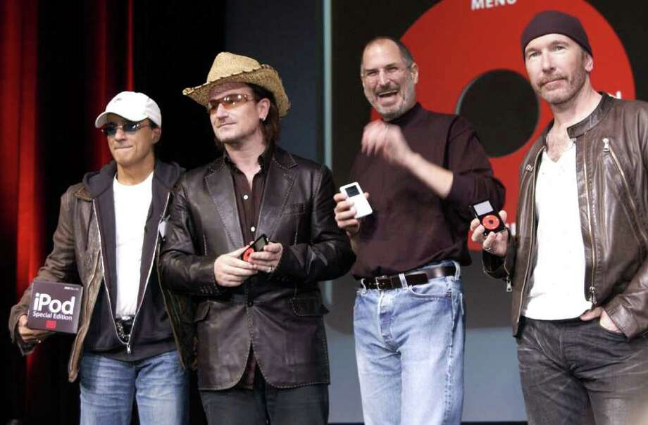 Steve Jobs (2nd-R) of Apple Computer poses with Interscope Geffen A&M Records Chairman Jimmy Iovine (L) Bono (2nd-L) and The Edge (R) of U2 at a celebration of the release of a new Apple iPod family of products at the California Theatre on October 26, 2004 in San Jose, California. Photo: Tim Mosenfelder, Getty Images / 2004 Tim Mosenfelder