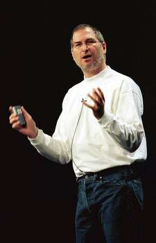 SAN JOSE, UNITED STATES:  Apple Computer interim CEO Steve Jobs delievers the keynote address at the Apple Worldwide Develper Conference 10 May 1999 in San Jose, California.  Jobs announced a new Powerbook computer that is faster, thinner and lighter than the the current models. He also announced that SEARS will be selling the popular iMacs.       AFP PHOTO/John G. MABANGLO Photo: JOHN G. MABANGLO, AFP/Getty Images / AFP