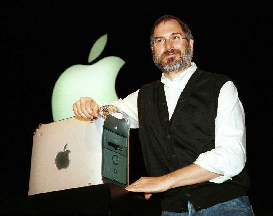 Apple Computer interim CEO and co-founder Steve Jobs introduces the new Power Mac G4 computer, now available to the public, during his keynote address at Seybold in San Francisco August 31, 1999. Jobs presented the G4 as the fastest personal computer in history saying it was up to a stunning 100 to 200 percent faster than the fastest Pentium III-based PCs. Photo: JOHN MABANGLO, AFP/Getty Images / AFP