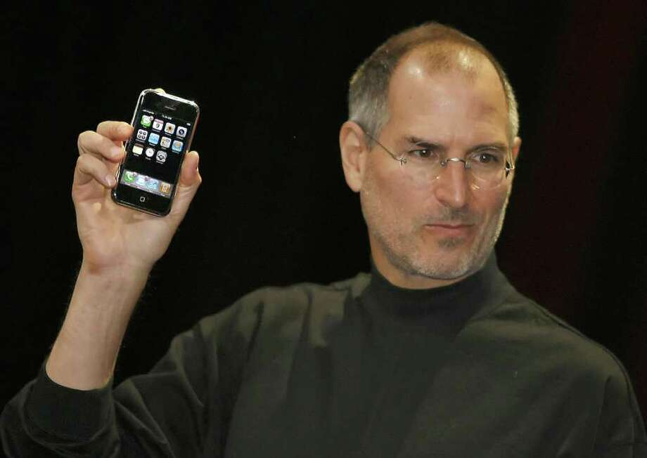 "Apple chief executive Steve Jobs unveils a new mobile phone that can also be used as a digital music player and a camera, a long-anticipated device dubbed an ""iPhone."" at the Macworld Conference January 9, 2007 in San Francisco, California.  Photo: AFP, AFP/Getty Images / 2007 AFP"