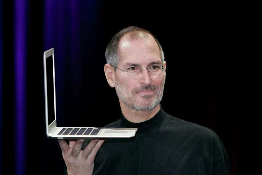 Apple CEO and co-founder Steve Jobs holds up the new Mac Book Air after he delivered the keynote speech to kick off the 2008 Macworld at the Moscone Center January 15, 2008 in San Francisco, California.  Photo: David Paul Morris, Getty Images / 2008 Getty Images
