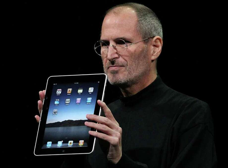 Apple Inc. CEO Steve Jobs holds up the new iPad as he speaks during an Apple Special Event at Yerba Buena Center for the Arts January 27, 2010 in San Francisco, California. Apple introduced the iPa. Photo: Justin Sullivan, Getty Images / 2010 Getty Images