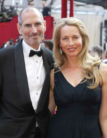 Apple's Steve Jobs and Laurene Powell arrive at the 82nd Annual Academy Awards held at Kodak Theatre on March 7, 2010 in Hollywood, California. Photo: Alexandra Wyman, Getty Images / 2010 Getty Images