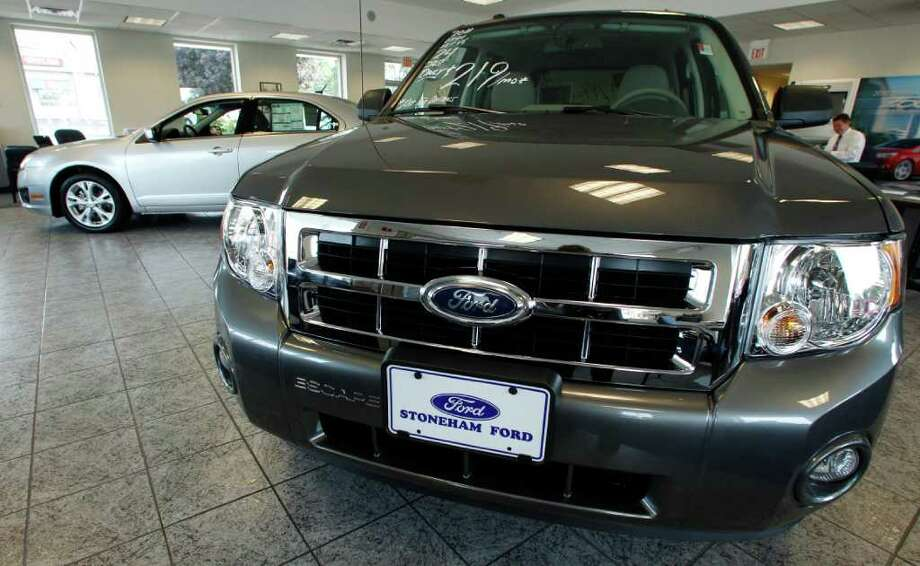 In this Aug. 18, 2011 photo, a 2011 Ford Escape compact SUV is on the showroom floor at Stoneham Ford in Stoneham, Mass. Companies ordered more aircraft and autos last month, driving up demand for long-lasting manufactured goods. But outside the transportation category, demand was weak. (AP Photo/Charles Krupa) Photo: Charles Krupa, STF / AP