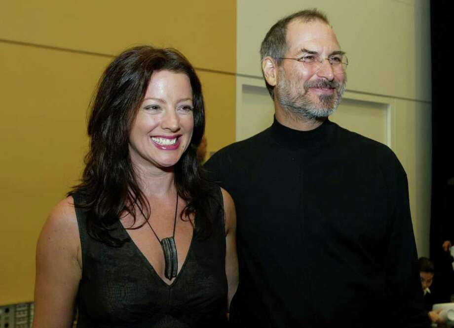 Apple CEO Steve Jobs (R) stands with singer Sarah McLachlan after he delivered a keynote address October 16, 2003 in San Francisco. Jobs announced the popular iTunes music program would now be able to be used on both Apple and PC computers and the successful 99 cent music store was adding thousands of new songs. Photo: Justin Sullivan, Getty Images / 2003 Getty Images
