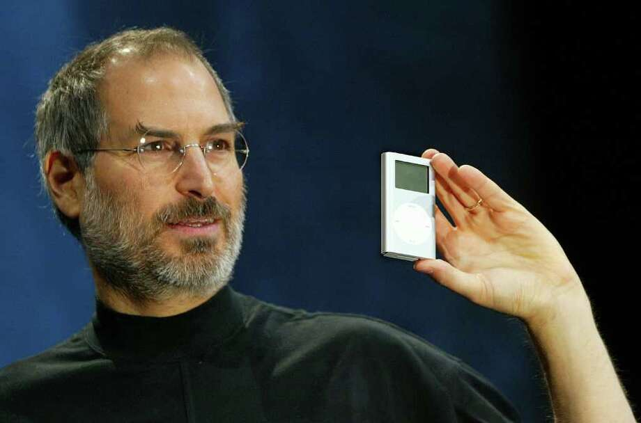 Apple CEO Steve Jobs holds a new mini iPod at Macworld January 6, 2004 in San Francisco.  Photo: Justin Sullivan, Getty Images / 2004 Getty Images