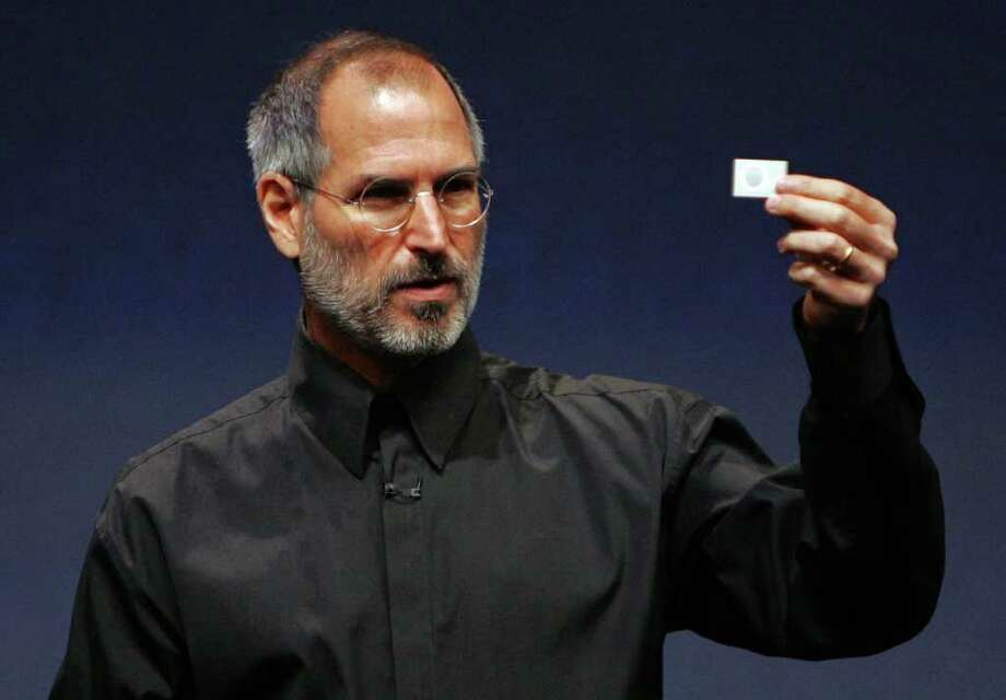 Apple CEO Steve Jobs holds up a new iPod Shuffle as he delivers a keynote address during an Apple media event September 12, 2006 in San Francisco. Photo: Justin Sullivan, Getty Images / 2006 Getty Images