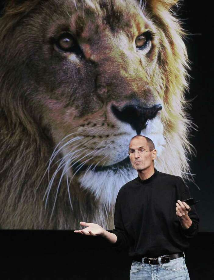 Apple CEO Steve Jobs announces the new OSX Lion operating system as he speaks during an Apple special event at the company's headquarters on October 20, 2010 in Cupertino, California. Jobs announced the new OSX Lion operating system for Mac computers and iLife 11.  Photo: Justin Sullivan, Getty Images / 2010 Getty Images
