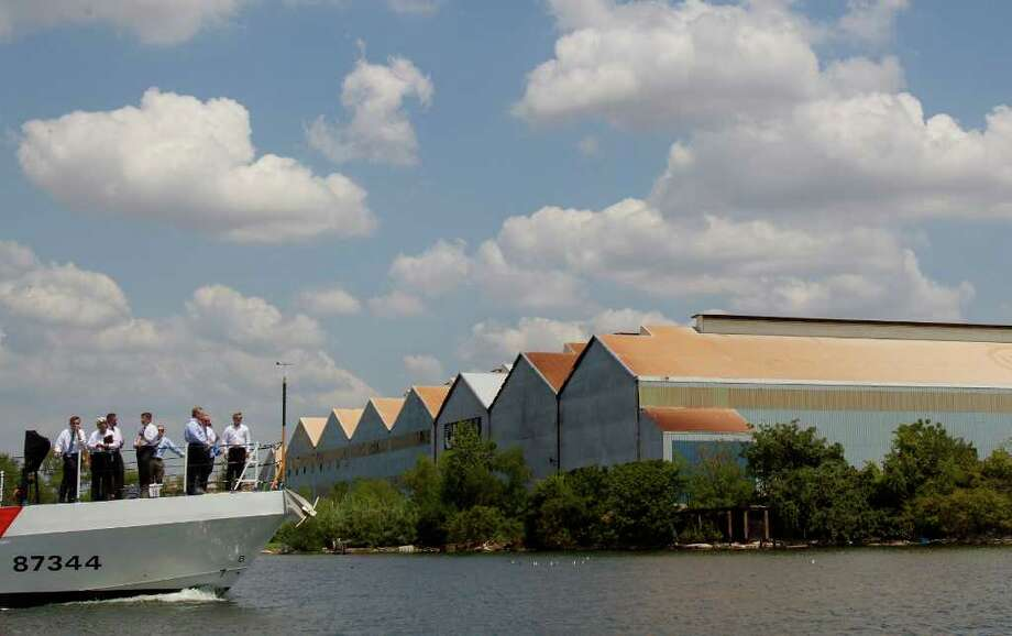 Port of Houston officials along with Representative Michael McCaul (R - TX) take a boat tour through the Houston Ship Channel Wednesday, Aug. 24, 2011, in Houston. Port officials showed McCaul different security measures taken to protect the port in case of an attack. (Cody Duty / Houston Chronicle ) Photo: Cody Duty, Staff / © 2011 Houston Chronicle