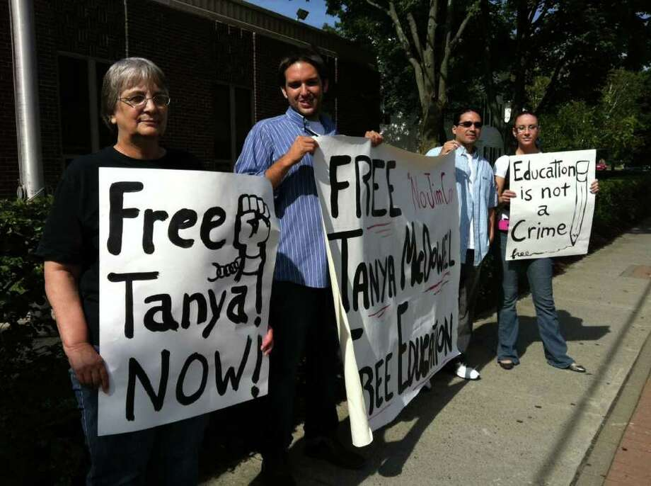 A group of protesters gathers outside state Superior Court in Norwalk, Conn. on Wednesday, August 24, 2011 to support Tanya McDowell, the Fairfield County woman facing larceny and drug-dealing charges. Chris Hutchinson, second from left, is the founder of the group, which is calling itself the Committee to Defend Tanya McDowell. Photo: John Nickerson