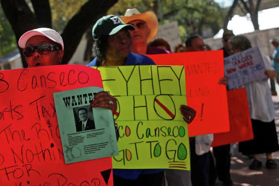 "Patricia Lenzy (left) joins others in a protest against Republican U.S. Rep. Francisco ""Quico"" Canseco outside La Villita Assembly Hall, where Canseco was speaking to the South San Antonio Chamber of Commerce. Photo: Lisa Krantz/lkrantz@express-news.net / SAN ANTONIO EXPRESS-NEWS"