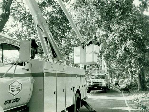 Hurricane Gloria  Sept. 30,  1985 - Baltimore Gas and Electric employees work for Northeast Utilities putting the lines back in order on Long Neck Point Road in Darien. Tom Ryan. Photo: File Photo, ST / Stamford Advocate File Photo