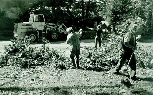 Hurricane Gloria  Sept.  28,  1985 - City workers clean up leaves, branches, trees etc.   Glenn Osmundson Photo: File Photo, ST / Stamford Advocate File Photo