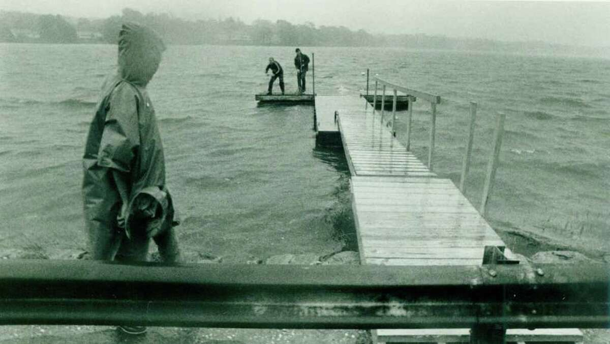 Hurricane Gloria Sept. 27, 1985 - People try to disassemble a dock Friday morning in the driving rain, just as Gloria struck.