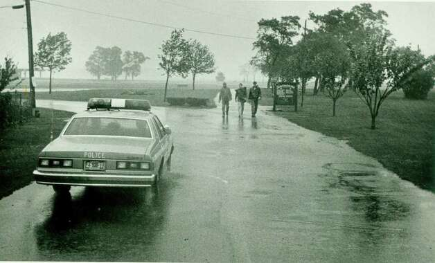 Hurricane Gloria  Sept.   27, 1985: Youths leave Cove Island Beach during the storm. Tom Ryan Photo: File Photo, ST / Stamford Advocate File Photo