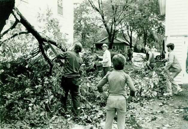 Hurricane Gloria  Sept.  27  1985: This tree which damaged the house in the background was cut up and carted to the street by neighbors of the Ridgeway St. house in Springdale. Tom Ryan Photo: File Photo, ST / Stamford Advocate File Photo