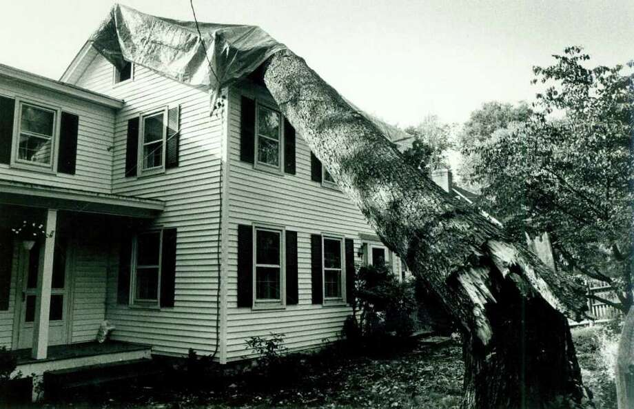 Hurricane Gloria  Sept. 30, 1985 - The Smiths of Brookside Road, Darien were still dealing with the results of the hurricane. The Smiths have temporarily covered the roof of their house with a large tarpelin until the tree which fell on the house could be removed and repairs made. Photo: File Photo, ST / Stamford Advocate File Photo
