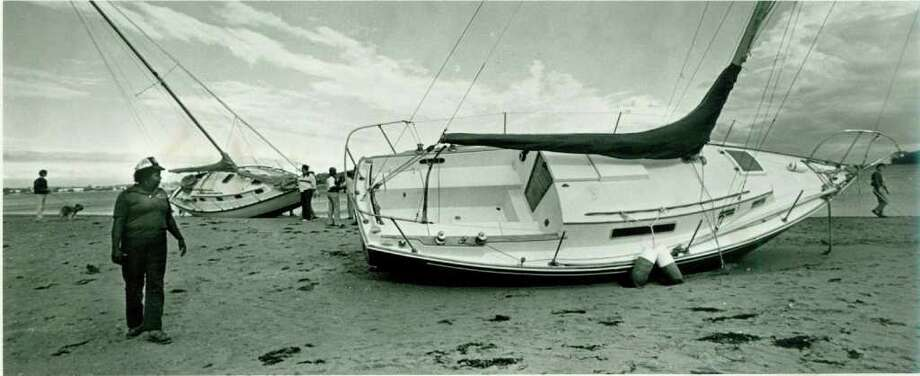 Hurricane Gloria  Sept.  27,  1985 - Two of several boats washed ashore at Calf Pasture Beach in Norwalk. Photo: File Photo, ST / Stamford Advocate File Photo