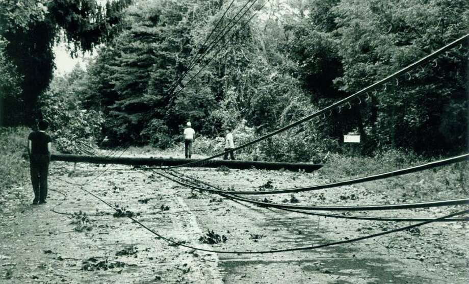 Hurricane Gloria  Sept.  27 or 28,  1985 Neighbors come out to see the damage on High Ridge Road above Briar Brae Rd.  where a tree knocked a telephone pole across High Ridge Road. Photo: File Photo, ST / Stamford Advocate File Photo