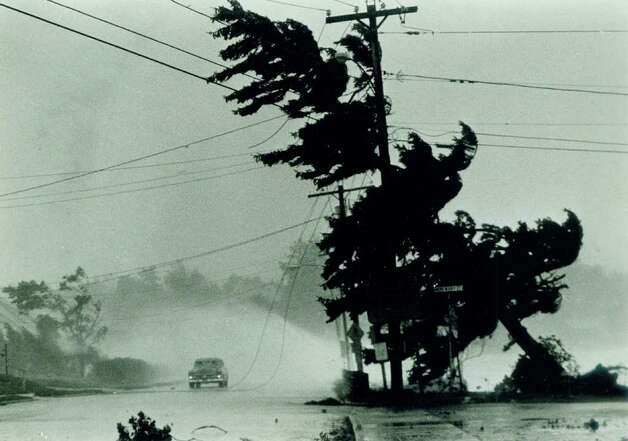 Hurricane Gloria  Sept.  27,  1985 - Milford - Waves from Long Island Sound break over a car stopped by power lines brought down by the tree on New Haven Avenue in MIlford, Conn. as Hurricane Gloria struck the Connecticut shoreline.  UPI photo / Frank Lorenzo Photo: UPI, ST / Stamford Advocate File Photo