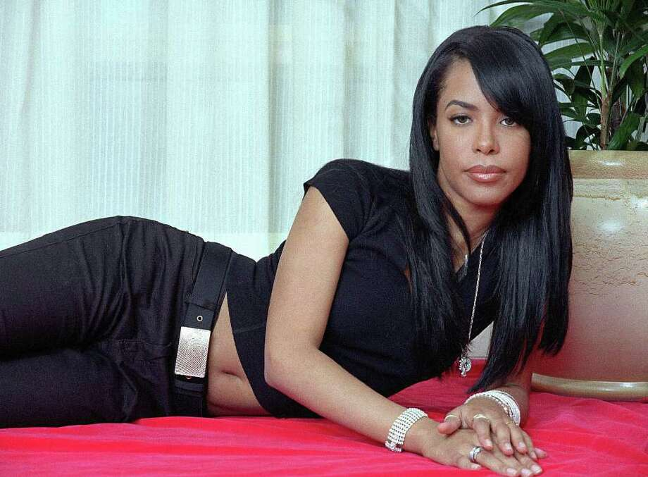 R&B singer-actress Aaliyah is shown in a 2001 photo taken three months before her death in a plane crash. Keep clicking to see other artists who have lost their lives the same way. Photo: JIM COOPER, AP / AP